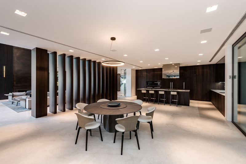 Texturized European smoked Oak has been used to create large vertical panels that separate the kitchen and living room.