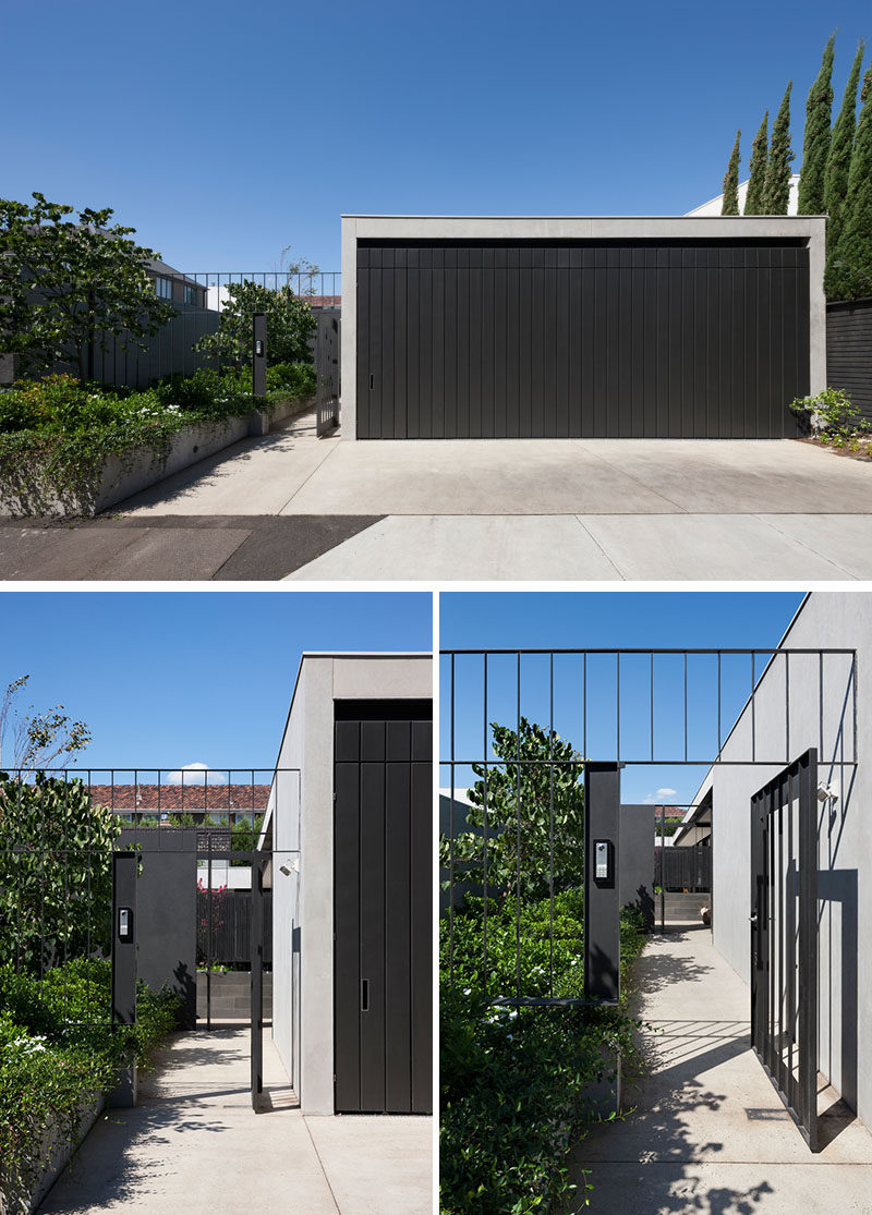 At the front of this modern house, a path sits next to the driveway and garage, and leads past a garden to the entry of the home. #ModernHouse #Garage #Path