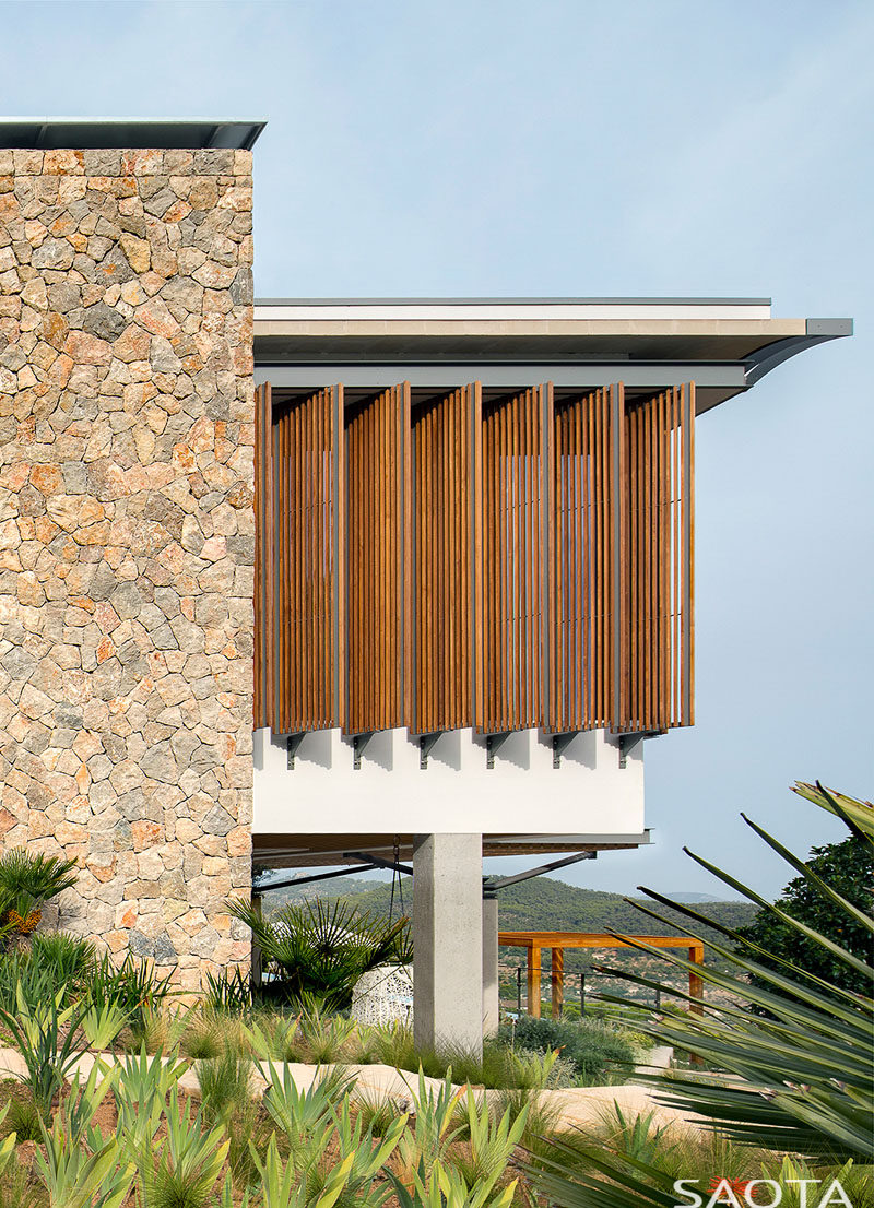 This modern house has wood shutters on its upper level. #WoodShutters #ModernShutters