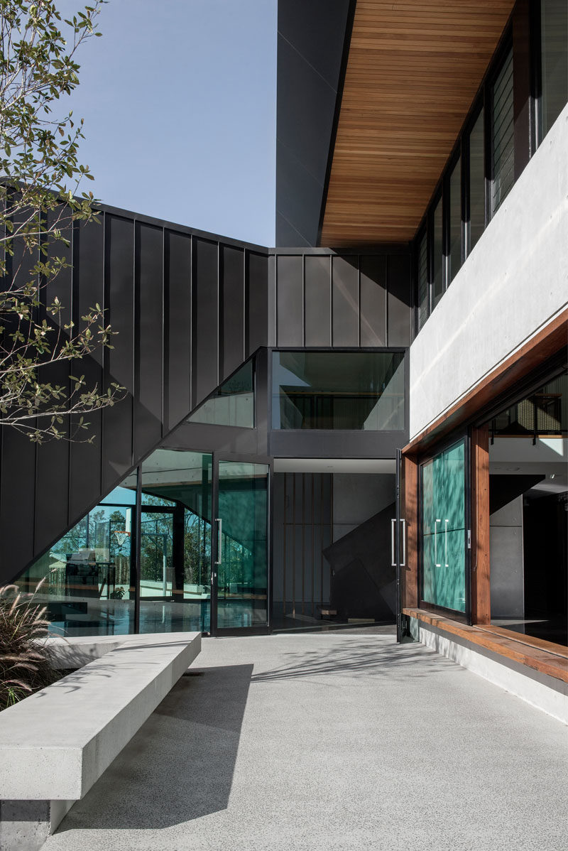 A dark zinc form has been used to connect a renovated church on the left and the new house on the right. #Architecture #ModernHouse