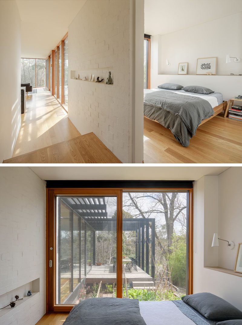 This simple modern bedroom has built-in shelving and a sliding door that opens up to a vegetable garden. #Bedroom #SlidingDoor