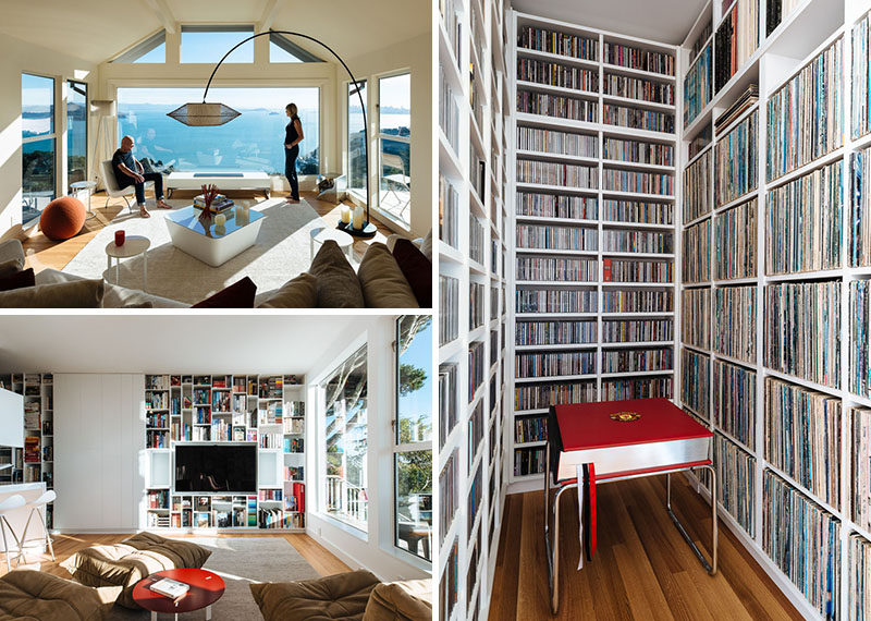 This modern house was transformed into a place to appreciate the home owners collections of vinyl records, design books, and vintage Coca-Cola bottles, while soaking in the ever-changing view. #LivingRoom #Bookshelves #Library