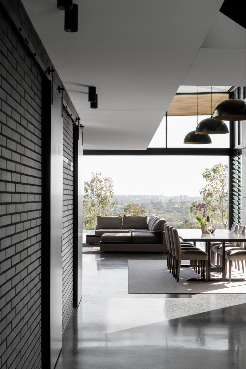 In this house, white walls and ceilings have been combined with dark brick to create a modern interior. #DarkBrick #ModernInterior