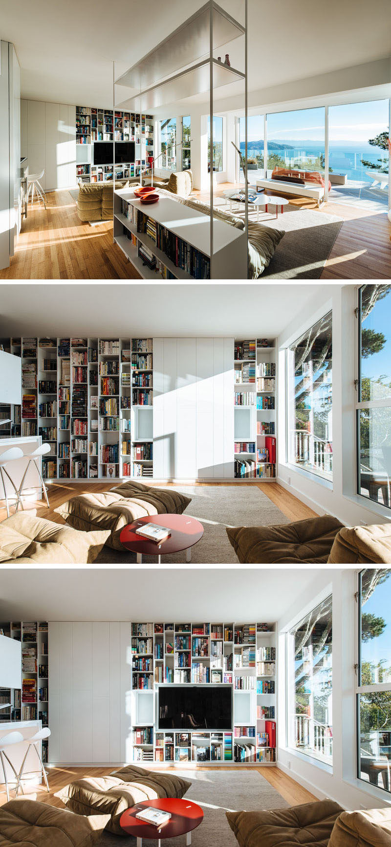 This modern home has a library that's filled with shelving and an open floor plan that takes advantage of the view. On one wall, floor-to-ceiling shelving has been added and the television when not in use, is hidden behind sliding white panels. #Shelving #HideTV #LivingRoom #Library