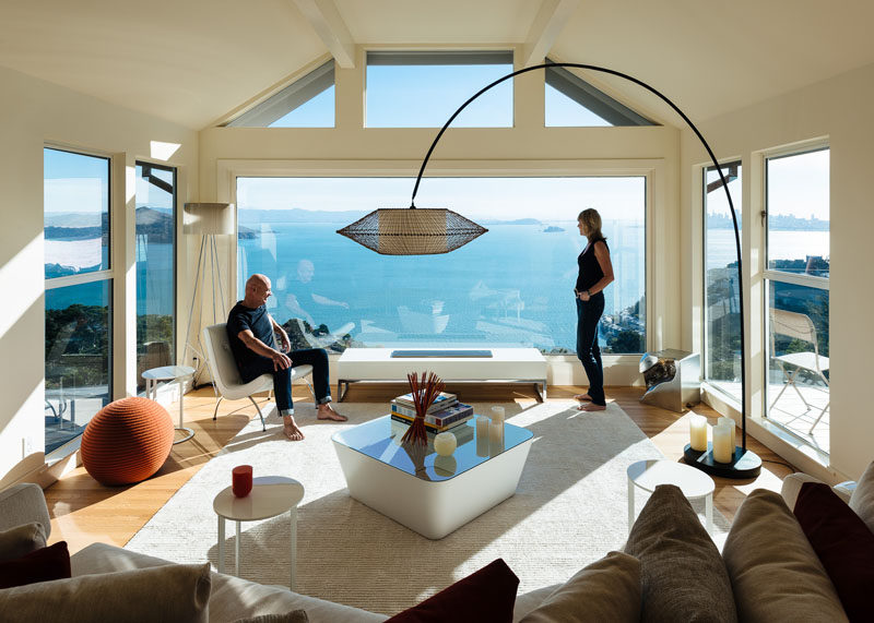 This modern living room has a large picture window that perfectly frames the water view.#LivingRoom #Windows