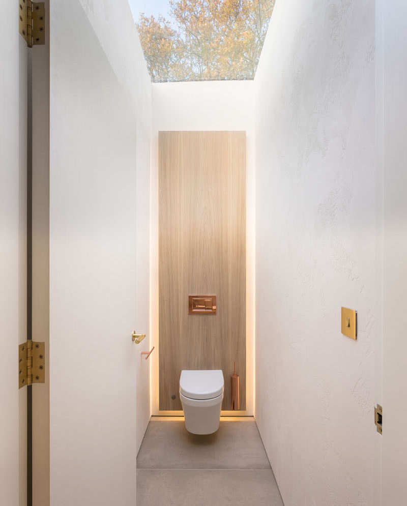 This powder room has a skylight that provides natural light to the small space. #Bathroom #Skylight