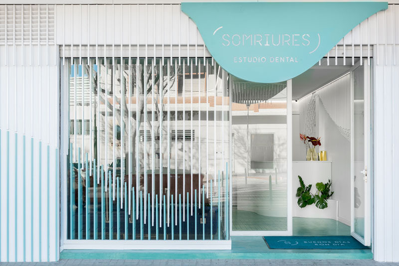 Masquespaciohave designed Somriures, a new modern dental clinic in a small town in Spain, that features a sculpture made from 2884 wood strips. #DentalClinic #InteriorDesign