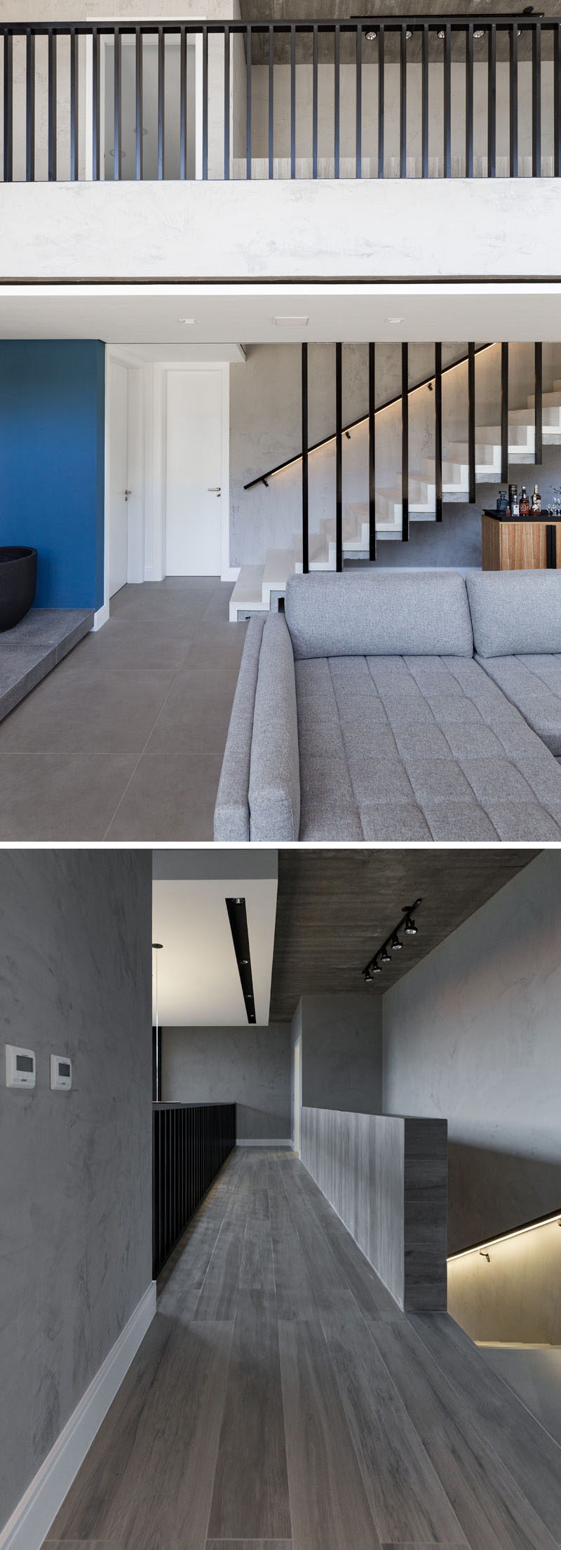 Stairs leading up to the upper floor of this modern house have a handrail with hidden lighting, and at the top of the stairs, a bridge walkway to the bedrooms overlooks the living room below. #ModernStairs #Handrail