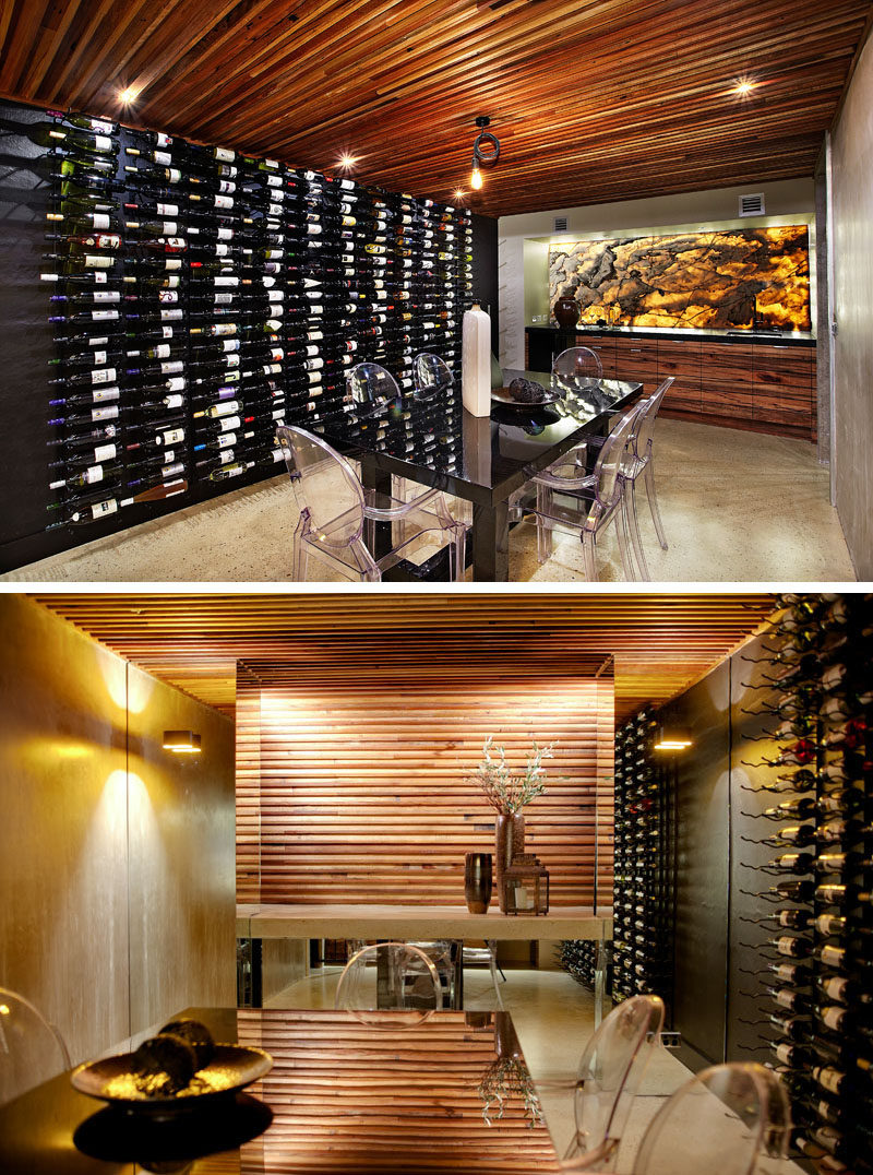 This modern house has a basement dining room cellar with a polished concrete floor, a curved re-claimed timber ceiling, mood lighting, floor-to-ceiling wine racks and a backlit onyx marble wall. #WineCellar #DiningRoom
