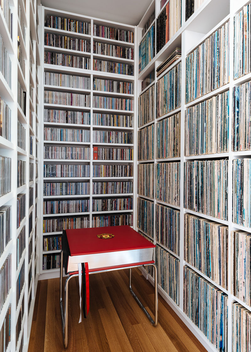 In this modern house, a small alcove has been custom designed to become a home for their extensive record collection. #Records #RecordStorage #Shelving