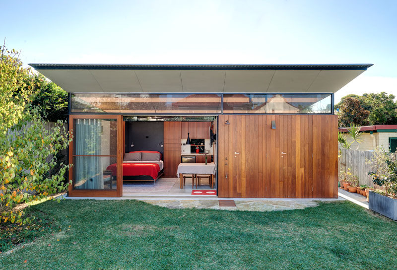 This Impressive Backyard Shed Combines Living Quarters, A Bathroom/Laundry, And An Indoor/Outdoor Workspace