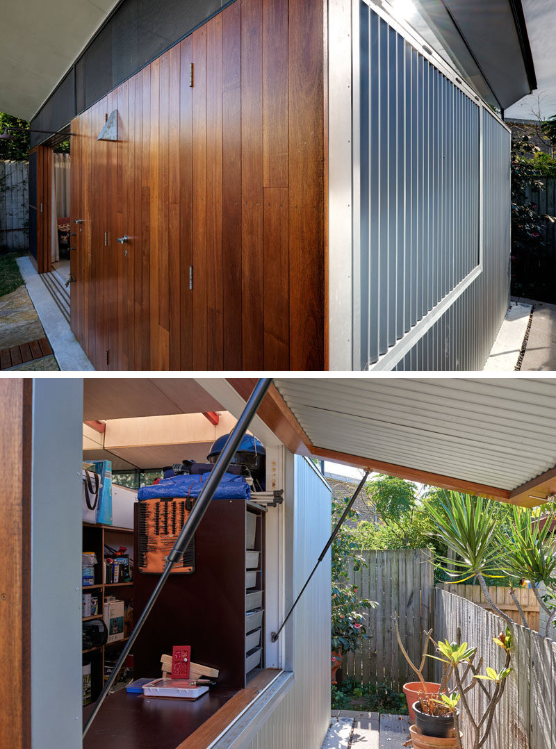 The exterior of this modern backyard studio that faces the garden is clad in a warm hardwood timber (blackbutt ) panelling, while Zincalume corrugated iron wraps around the remaining three sides of the structure, protecting it from the elements. #BackyardStudio #WoodFacade #CorrugatedSiding