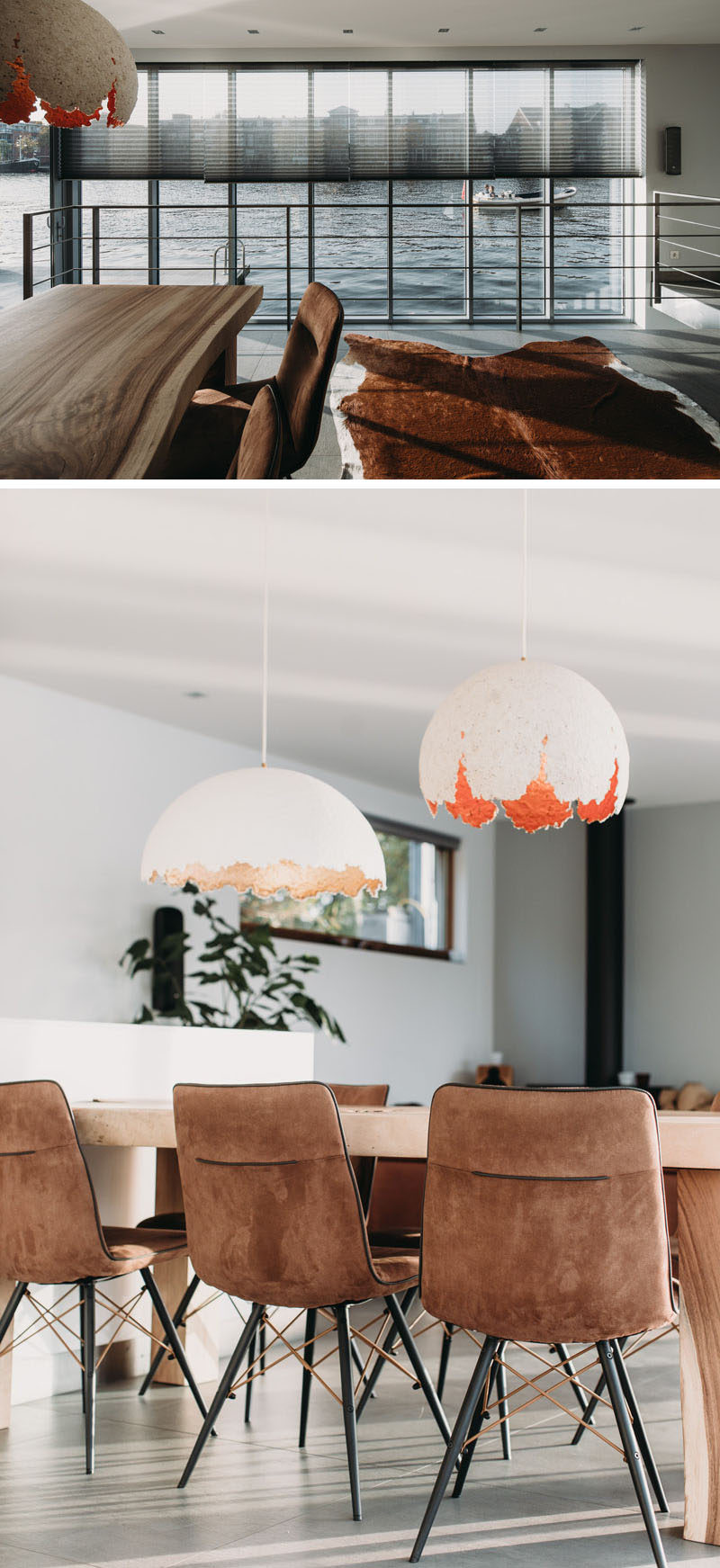This modern houseboat has a wall of windows that provide views and allow natural light to filter through to the interior. In the dining area, a wood dining table sits below two sculptural pendant lights. #DiningRoom #Windows