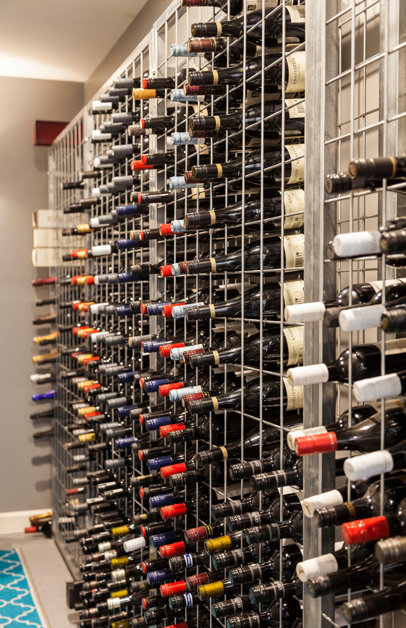 This wine cellar has a metal cage-like shelving unit to store the wines. #WineCellar #WineStorage