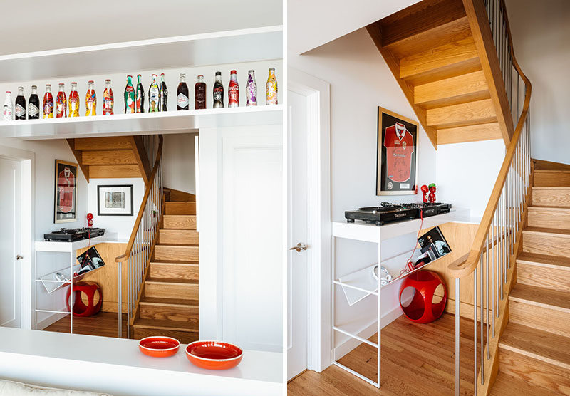 Wood stairs connect the different floors of this home, and at the bottom of the stairs, is a small music area with a couple of turntables. #RecordPlayer #InteriorDesign #WoodStairs
