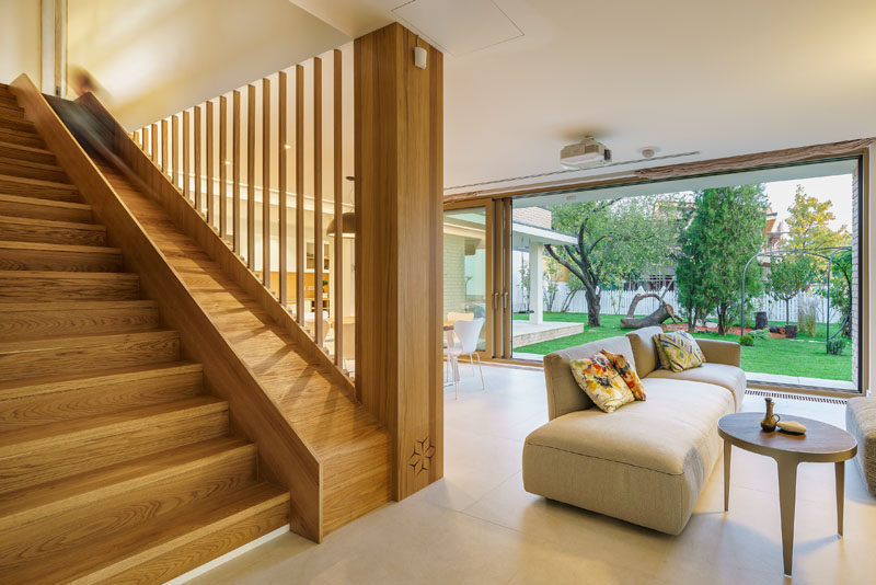 A BuiltIn Slide Makes The Wood Stairs In This House Fun For Kids