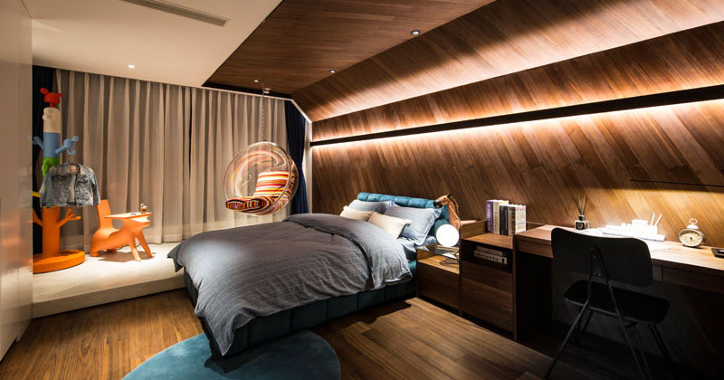 Design Detail - This Children's Bedroom Features A Wrap Around Wood Accent Wall With Hidden Lighting