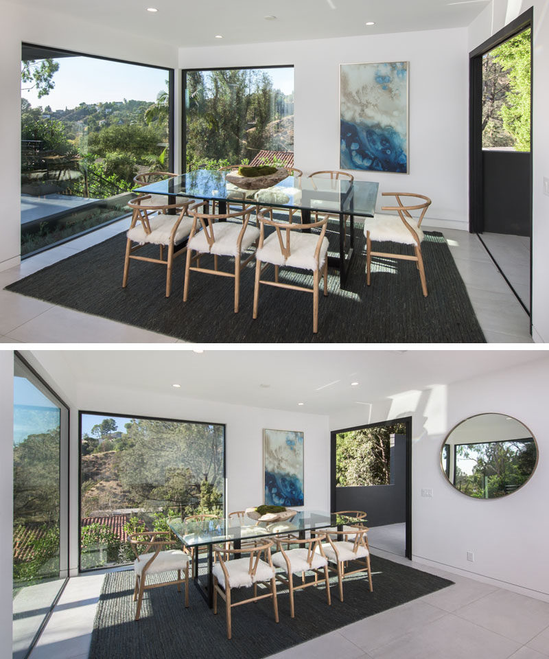 In this modern dining room, large picture windows provide tree views and act as secondary pieces of art. #DiningRoom #Windows