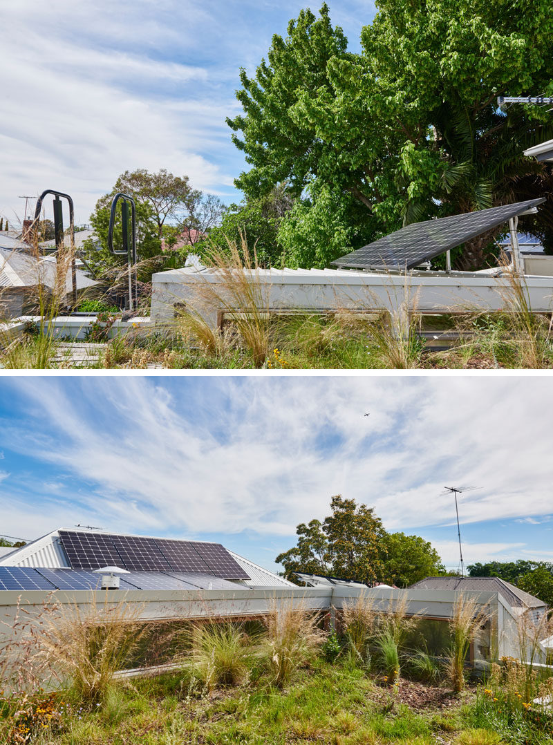 On the roof of this renovated house are some solar panels and an insulating green roof. #SolarPanels #GreenRoof