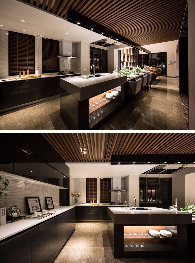 This Long And Modern Kitchen Island Is Home To A Bar, A Six Person Dining
