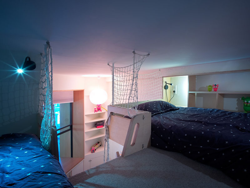 This lofted bedroom has enough room for two beds, and a simple net feature protects the children from falling to the space below. #LoftedBedroom #KidsBedroom