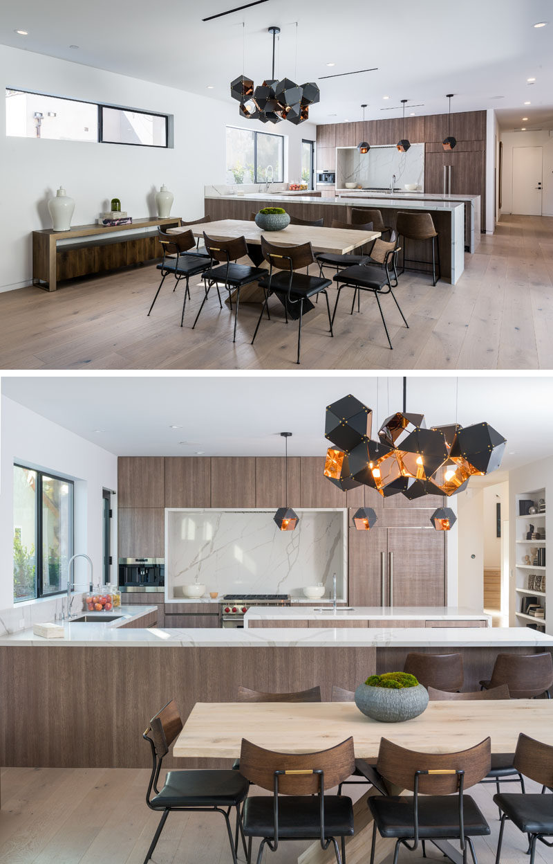 A modern and geometric chandelier sits above the dining table and anchors it in the large open plan room. #DiningRoom #Lighting
