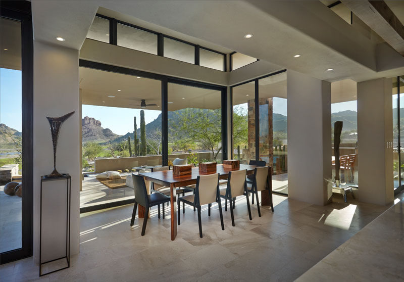 This contemporary dining room features wide glass panes that perfectly show off the view. #Windows #DiningRoom