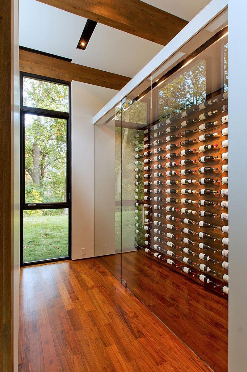 This modern house has a dedicated space for wine storage, with a glass front to show off the organized display. #WineStorage #WineDisplay