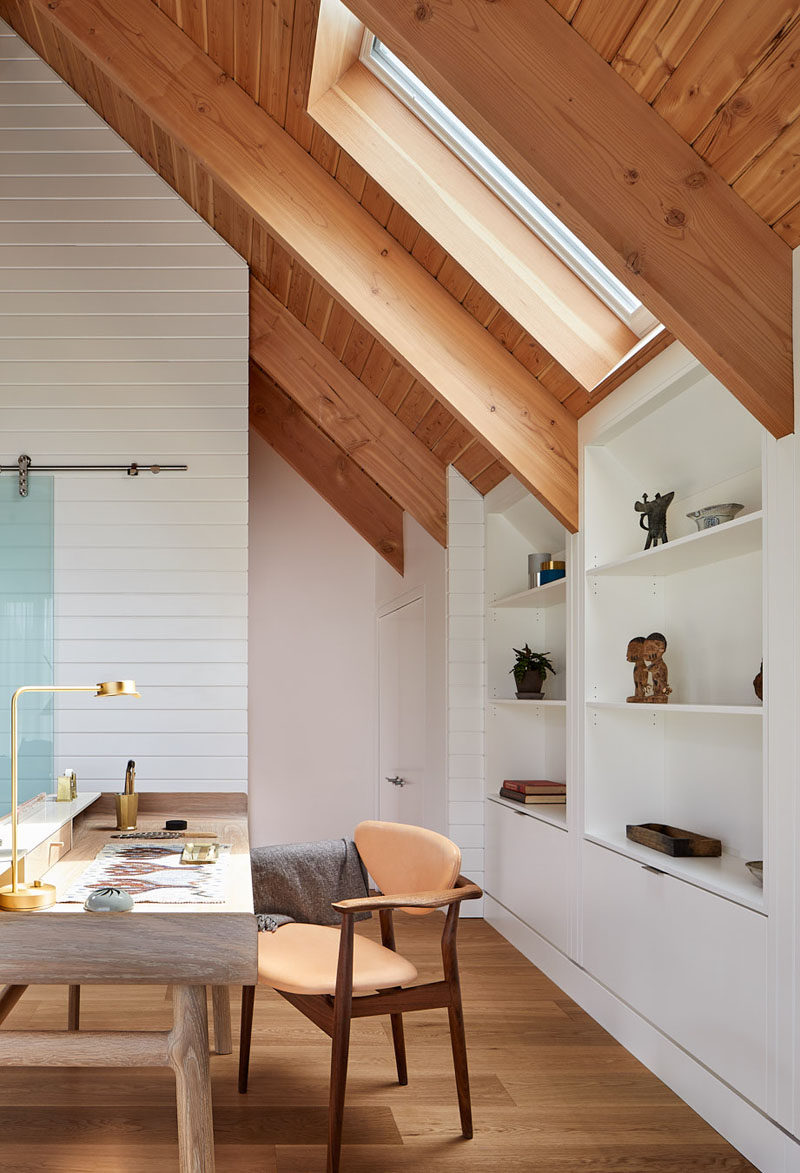 This loft space above a garage has been set up as anartist's studio and a self-contained guest suite. #Loft #ArtStudio #GuestSuite