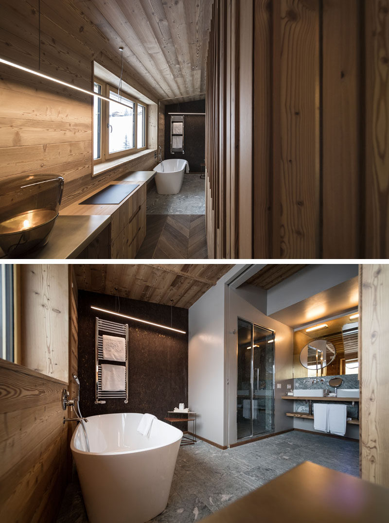 A small hallway off the bedroom opens up to a modern bathroom. In the bathroom, there's a freestanding bathtub and an enclosed shower. #ModernBathroom #BathroomDesign