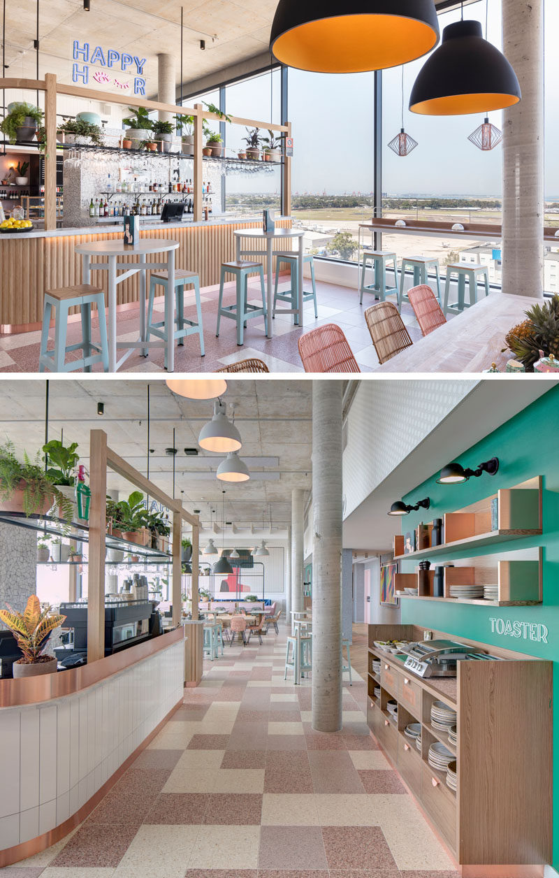 This modern hotel has a bar and breakfast station, with double-height windows for optimal views. #ModernHotel #HotelBreakfastStation