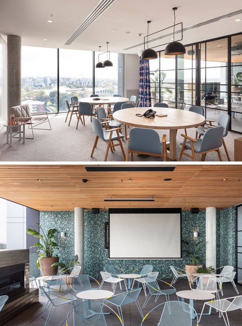 This modern hotel has a social area with round tables that has a glass wall that leads out to the outdoor cinema space with a fireplace and casual seating. #OutdoorCinema #HotelDesign