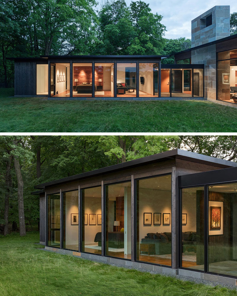 The materials used on the exterior of this modern house is dark-stained cedar wood and glass with a stone base and fireplace of bluestone. #Architecture #BuildingMaterials #HouseDesign