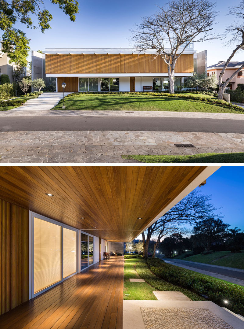 The design of this modern house uses two large concrete walls on the sides to block the neighbors' views to the house, granting privacy for the home owners,while an overhang creates a place to sit outside and street view. #ModernHouse #Architecture