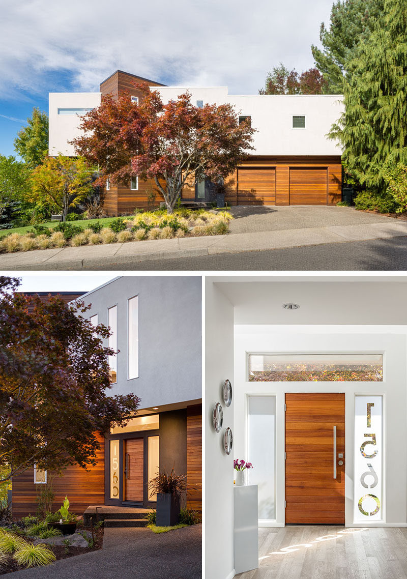 This modern house has a horizontal wood front door with the house numbers etched into the