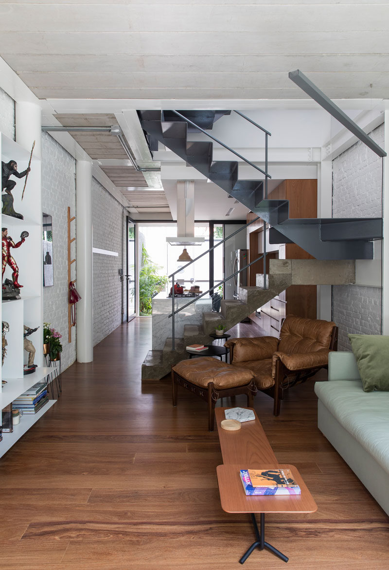 The stairs in this narrow modern home combine concrete and steel for a slight industrial look. #Stairs #StairDesign