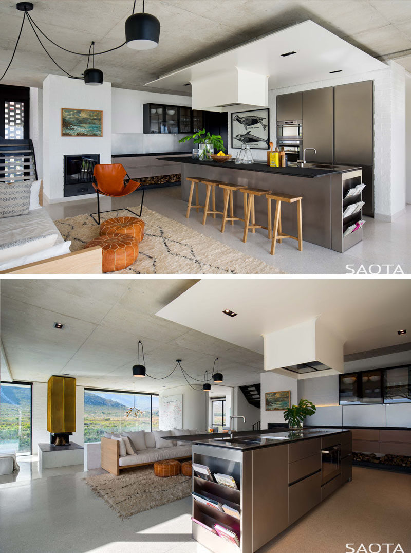 In this modern kitchen, a long island has enough room to seat five people, and at one end of the island, there's a small bookshelf / magazine rack. #KitchenDesign #ModernKitchen