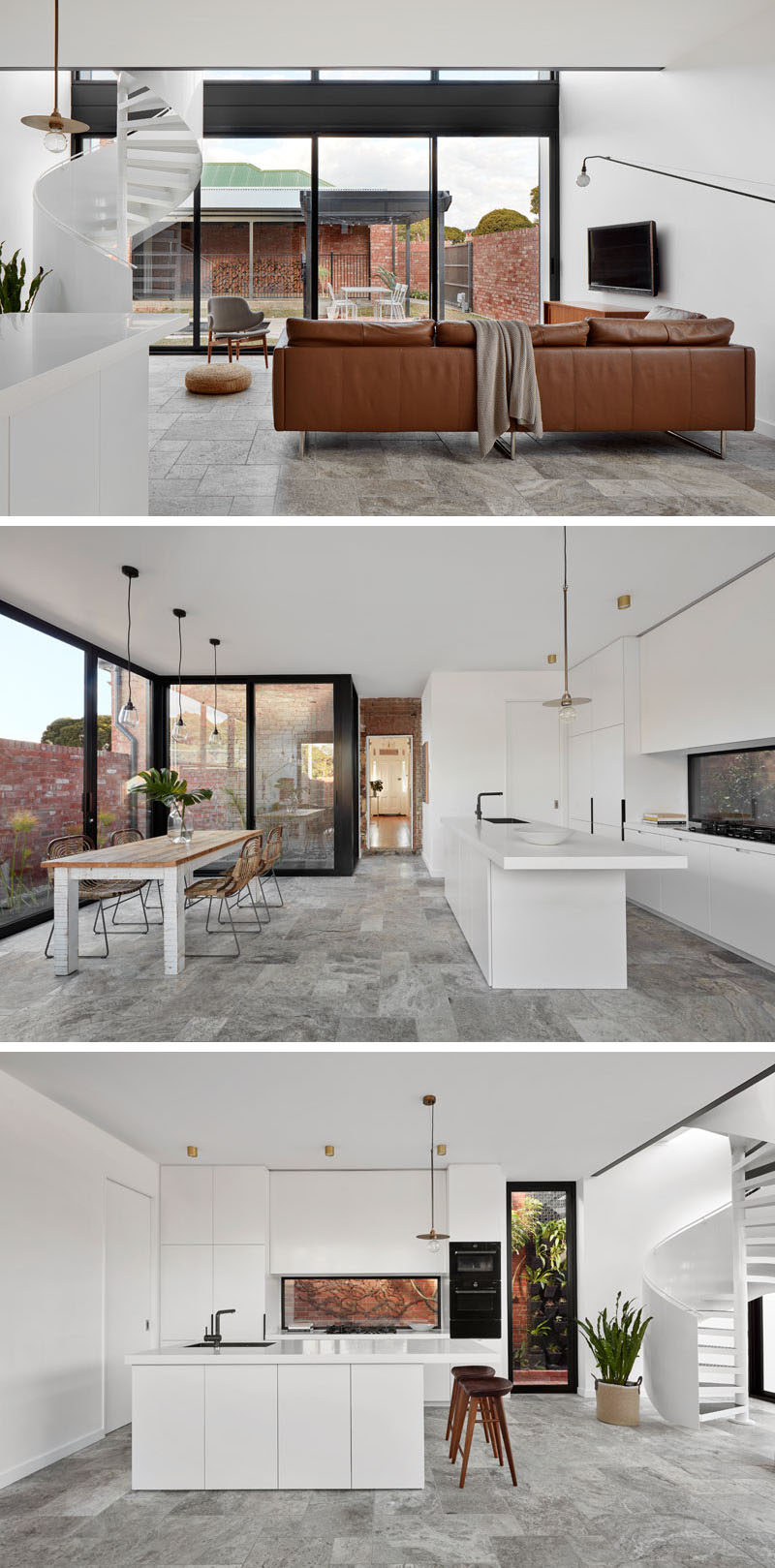 The bright white ground floor of this modern house extension has been designed as an open plan space with views of the backyard through the double height wall of windows. In the kitchen white cabinets have been paired with a Corian White Jasmine countertop. #LivingRoom #WhiteKitchen #ModernInterior