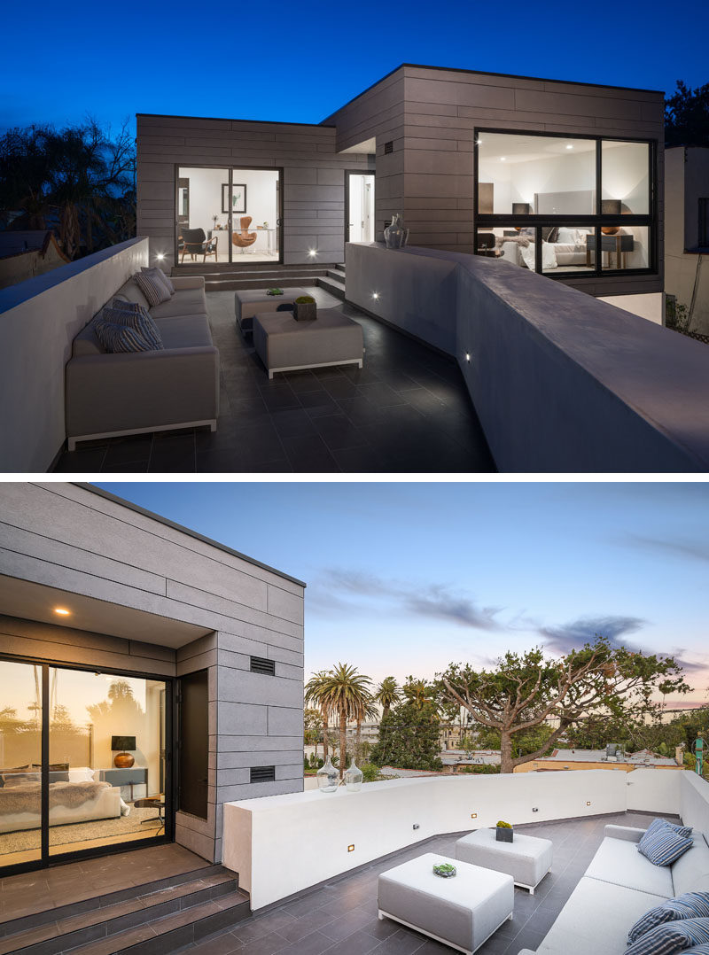 This rooftop patio, which is furnished with a couch and a few ottomans, can be accessed from the backyard as well as the master bedroom and office. #RooftopPatio #OutdoorSpace