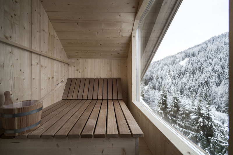 This penthouse suite at an Italian hotel has a sauna with a large picture window for viewing the mountains. #Sauna #Windows