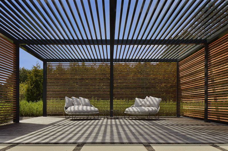 """This garden also has asemi-enclosed square pergola structure with 2"""" x 4"""" ipe slat walls and hollow aluminum slats overhead. #ModernPergola #Landscaping #OutdoorSpace"""