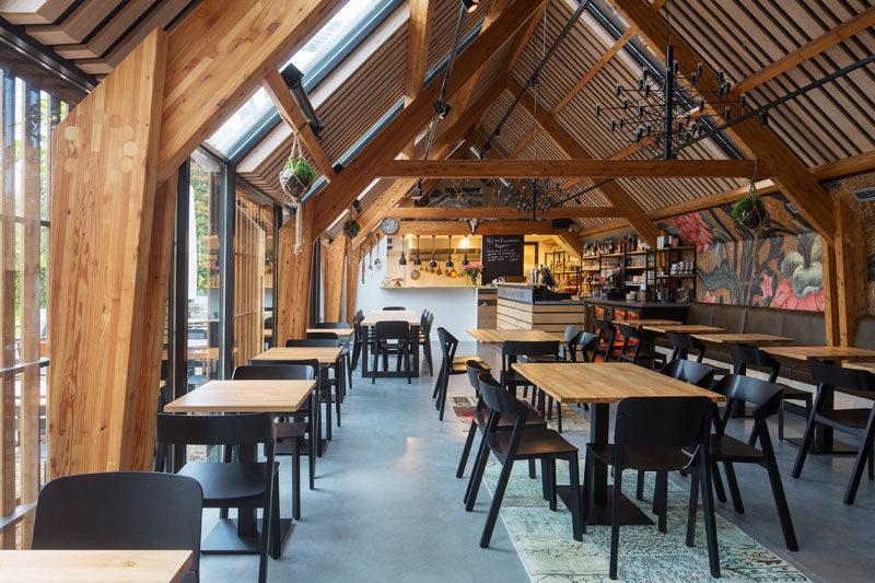 This restaurant is located in a barn-like building that shows off the structure of the building. #Restaurant #Architecture