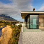 The Restio River House By SAOTA Has Views Of The Surrounding Mountains