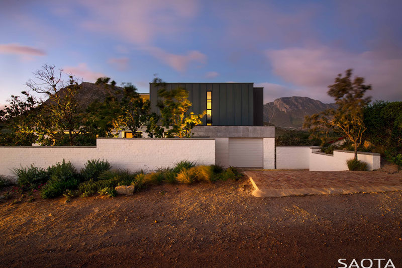 SAOTA have designed a new family holiday home that's perched on the banks of the Buffels River, close to Pringle Bay in South Africa. #ModernHouse #ModernArchitecture