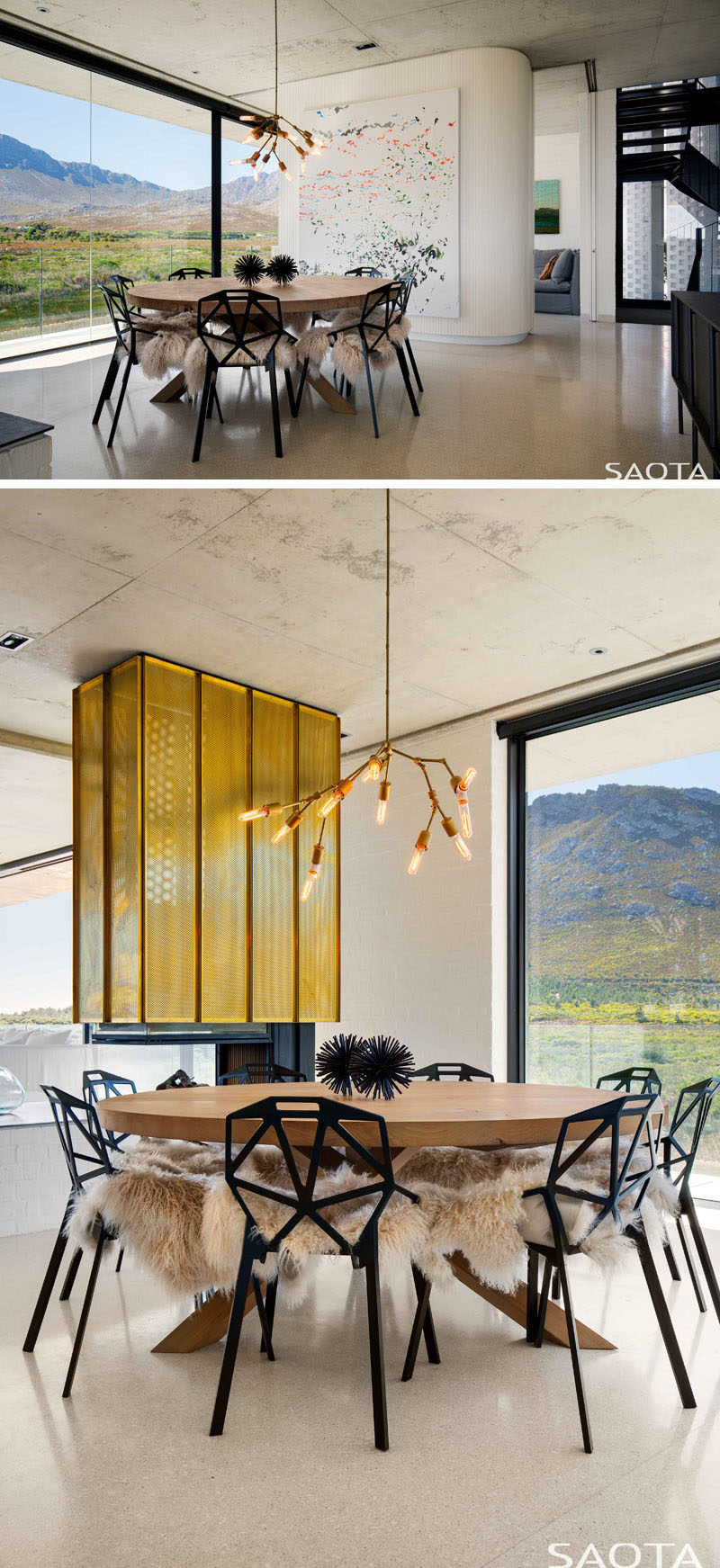This modern house has a fireplace with punched brass cladding. Next to the fireplace is the dining room that features a custom-made table by James Mudge, accentuated by the Lindsey Adelman pendant light. Black Magis chairs surround the table and are softened with sheepskins throws. #Fireplace #ModernDiningRoom