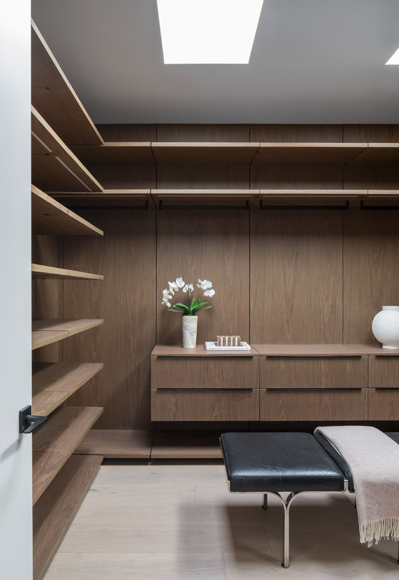 This modern walk-in closet has plenty of space to hang, display and put away clothes. #WalkInCloset