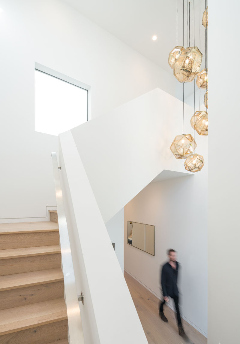 Wood and white stairs lead to the upper floor of this modern house. #Stairs #StairDesign