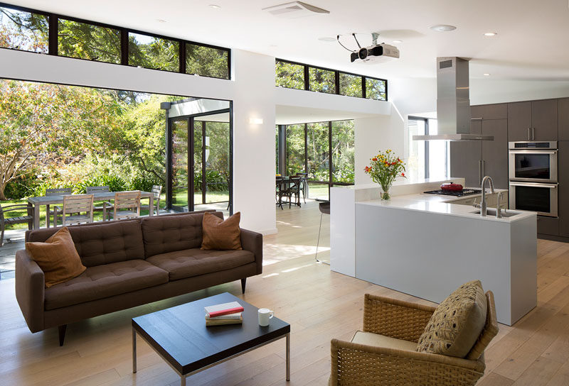 Sliding glass doors have been used to create an indoor / outdoor living environment for this modern house. #ModernInterior #SlidingGlassWalls