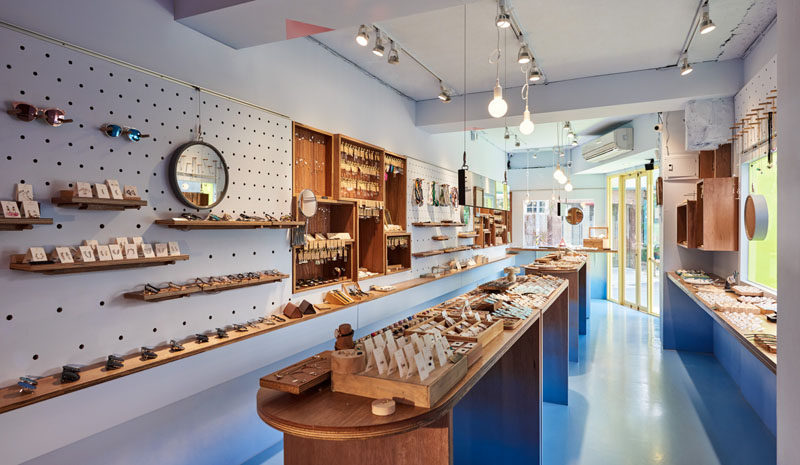 This modern retail store has pegboard walls that allow the owners of the store to display all product and if needed the shelves and hooks can easily be moved to change the layout of the walls. #RetailStore #Shelving #Pegboard