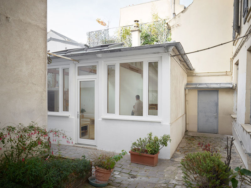 This small building that was once a garage and then an artist studio, has been transformed into a small house with a kitchen, bedroom, bathroom and lofted work area. #SmallHouse